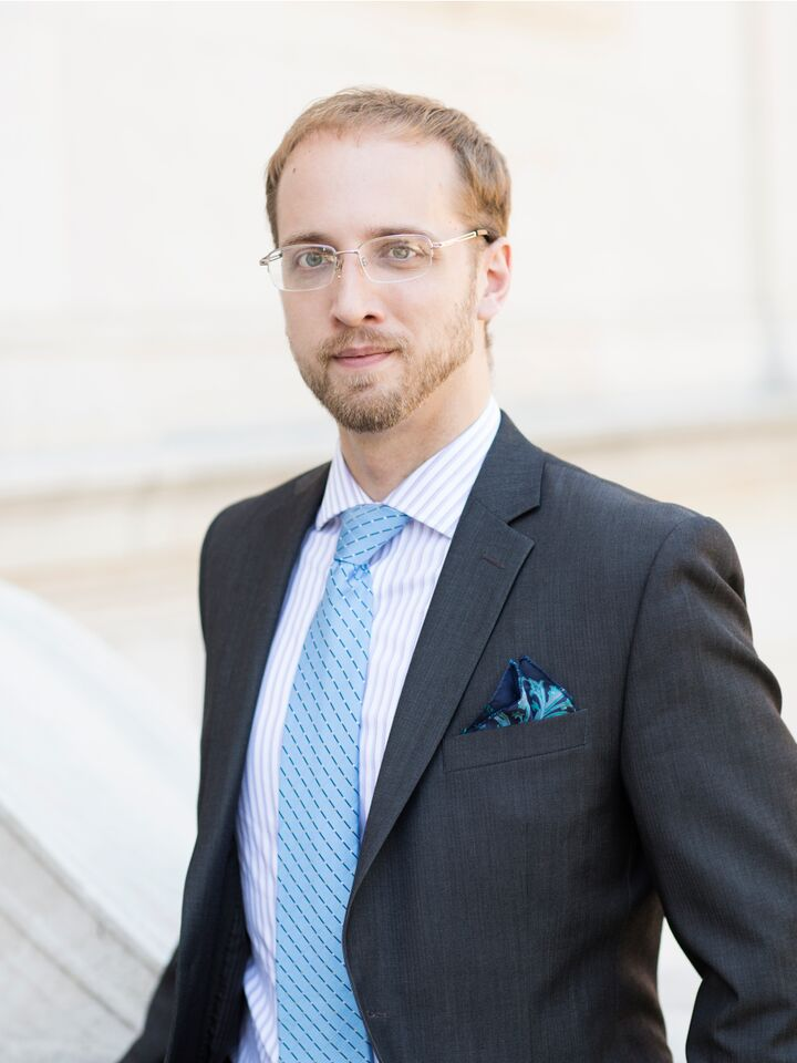 lawyer Zachary Aaker dressed in a suit